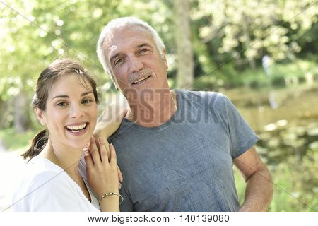 Portrait of man with daughter