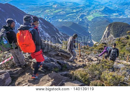 Ranau,Sabah,Borneo-March 13,2016:Group of climbers move down from Low's Peak to Laban Rata check point at Mountain Kinabalu on 13th Mac 2016.There are two summit trails,Ranau Trail & Kota Belud Trail