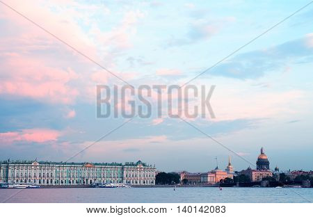 View of Winter Palace across Neva river at sunset Saint Petersburg Russia