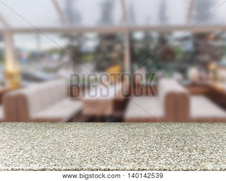 Marble board empty table in front of blurred background. Perspective marble table over blur in cafe interior - can be used for display or montage your products. Mockup your products