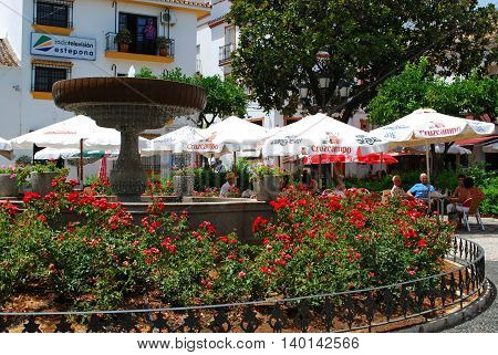ESTEPONA, SPAIN - JULY 18, 2008 - People relaxing at pavement cafes in the Plaza las Flores Estepona Malaga Province Andalucia Spain Western Europe, July 18, 2008.