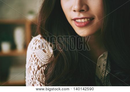 Cropped image of young woman with beautiful smile