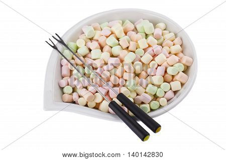 bowl of colorful marshmallow and fondue isolated on white background