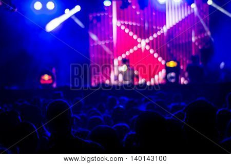 De-focused audience at a concert in the concert hall