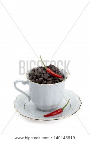 a cup with chocolate chips and chili