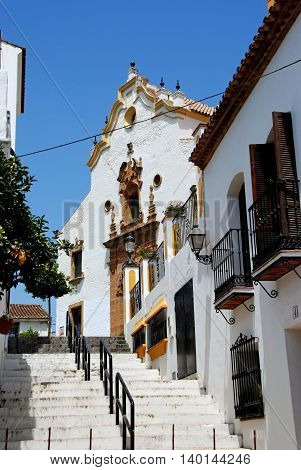 ESTEPONA, SPAIN - JULY 18, 2008 - View up a stepped street towards the church (Iglesia de Nuestra Senora del los remedios) Estepona Malaga Province Andalucia Spain Western Europe, July 18, 2008.