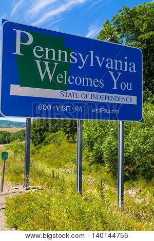 Lawrenceville PA - July 26 2016: A Pennsylvania Welcomes You sign along I-99 at the NY and Pa border in Tioga County PA