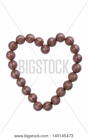 heart shaped by chocolate kisses isolated on white background