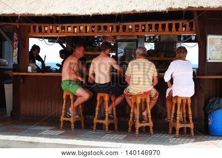 ESTEPONA, SPAIN - JULY 18, 2008 - People sitting at the Chiringuito la Peseta beach bar Estepona Malaga Province Andalusia Spain Western Europe, July 18, 2008.