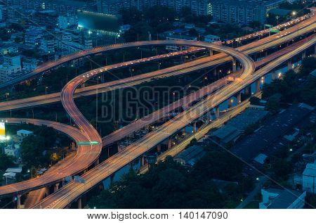 Highway intersection and Urban in Aerial view Night Light of Cityscape in Bangkok Thailand