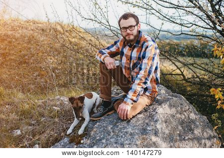 boy on a walk in the woods with the dog