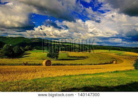 Landscape with hay rolls  near Vianden, Luxembourg