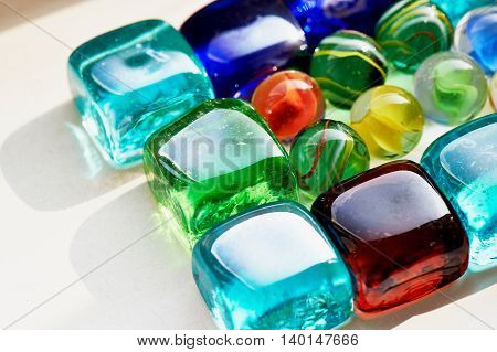 Colorful glass colorful square and round stones. Macro