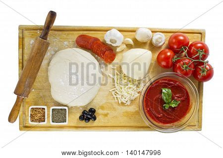ingredients for homemade pizza on wooden board