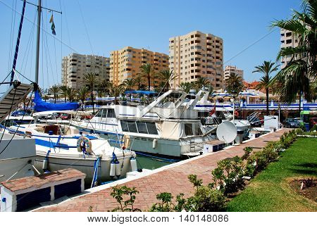 ESTEPONA, SPAIN - JULY 18, 2008 - View of boats and yachts in the marina with buildings to the rear Estepona Malaga Province Andalusia Spain Western Europe, July 18, 2008.