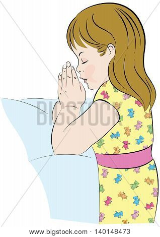Girl praying, in her pajamas, kneeling beside her bed.