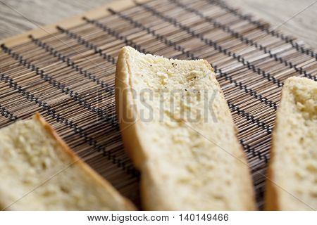 buttered toasted baguette bread with garlic spread and pepper