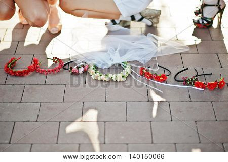 Wreath Of Girls On Bachelorette Party On Pavement