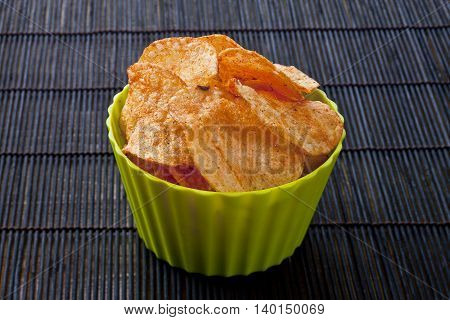 cheese flavored potato chips in green bowl