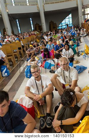 CRACOW POLAND - JULY 26 2016: World Youth Day 2016 - Crowd of Pilgrims inside of the Sanctuary of Divine Mercy in Lagiewniki. Cracow Poland