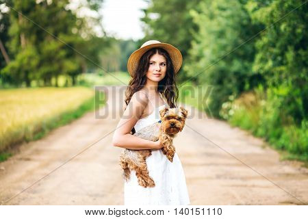 pretty woman beautiful young happy with long dark hair in white dress holding small dog