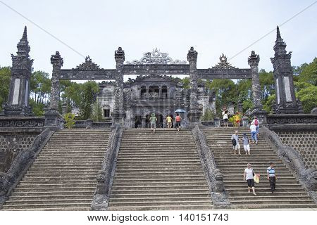 Hue, Vietnam - Jun 17, 2016: Tourist visiting Khai Dinh imperial tomb building, the most beautiful king's tomb in Hue. Imperial Royal Palace here is recognized World Heritage Site by UNESCO.