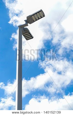 Abstract sportlight on blue - sky background