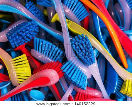 Red blue yellow brush for washing dishes. lie in a pile.