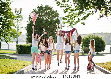 Seven Happy And Sexy Girls On Short Shorts Throw Up Shirts And Having Fun At Park On Bachelorette Pa