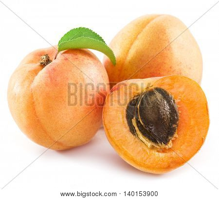 Apricots and its cross- section on the white background.