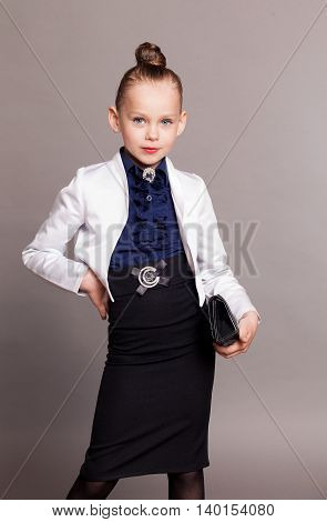 little girl dressed as a business Lady