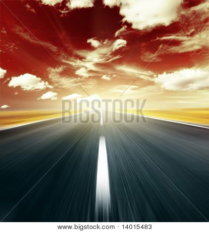 Blurry road and abstract red sky with clouds