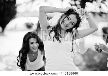 Smiled girl on bachelorette party. Black and white photo
