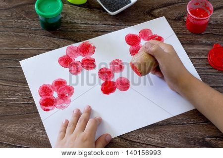 The Child Makes Drawing On Paper By Using The Print Potatoes And Fingers. Glue, Paint, Paper And Pot