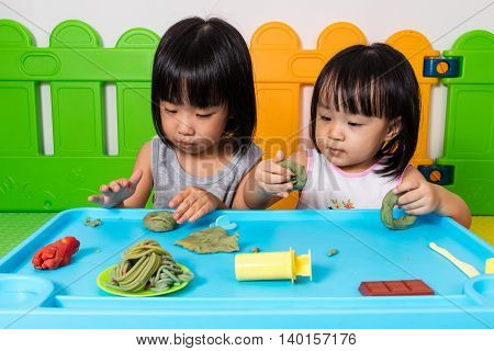 Asian Little Chinese Girls Playing With Colorful Clay