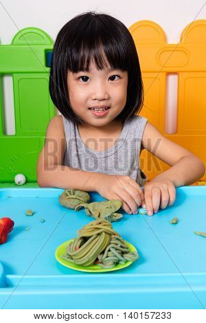 Asian Little Chinese Girl Playing With Colorful Clay