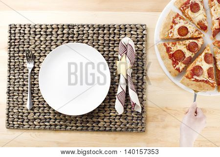 white plate waiting for the slice on pizza