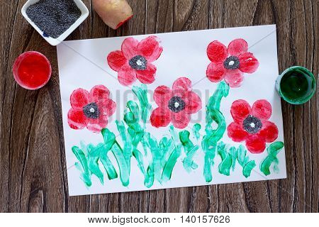 Drawing On Paper Poppies Made In The Technique Of Fingerprint Potatoes And Fingers. Glue, Paint, Pap