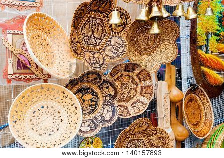 VELIKY NOVGOROD RUSSIA-JULY 22 2016. Objects made of birch bark with various forms and patterns - traditional Russian Slavic handmade tableware. Souvenir trade.
