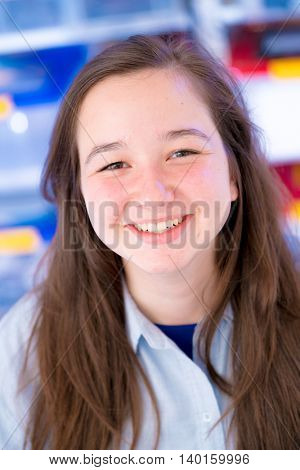 Portrait of smiling teen girl, soft focus with bokeh. look at camera