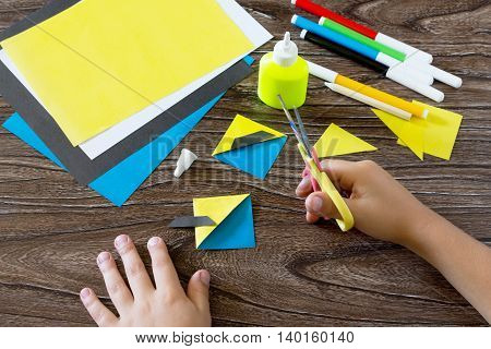 The Child Makes A Book With A Bookmark Mignon. The Child Carves The Details Of Paper Products. Glue,