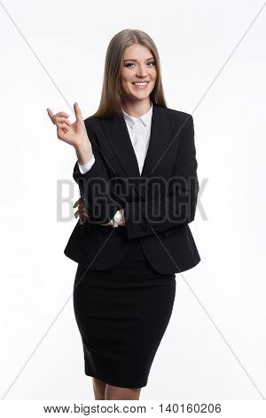 Attractive girl in a business suit shows a hand. On a white background.
