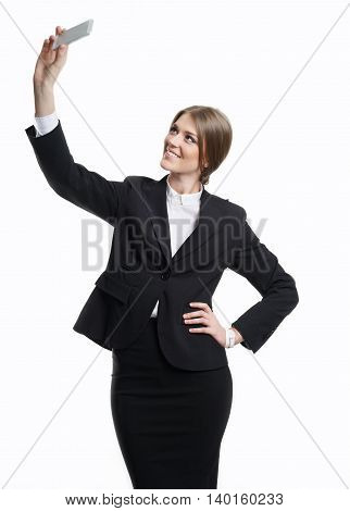 Successful business woman making selfie on your smartphone.