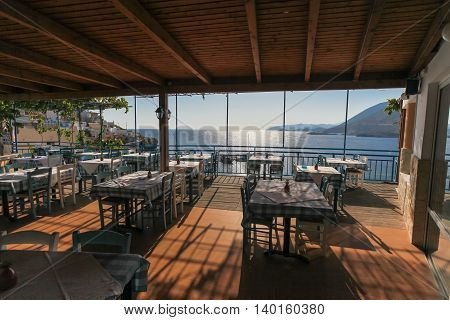 Restaurant with view on the sea and mountains. Fish Village Bali on Crete island in Greece.