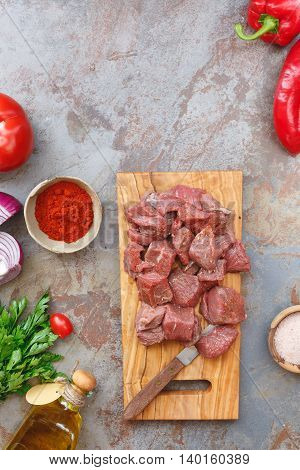 Chopped raw meat with vegetables and herbs, ready to cook, Top view, blank space above