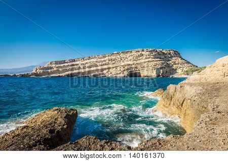 Matala beach on Crete island, Greece. View from the rocks. There are many caves near the beach.