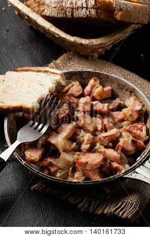 Pieces Of Sausage Fried With Onions