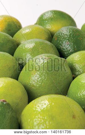 Lime juicy summer fruit raw food on background