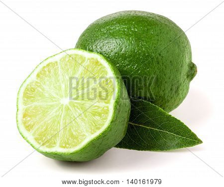 lime with half and leaf isolated on white background.