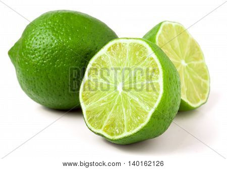 lime with two halves isolated on white background.
